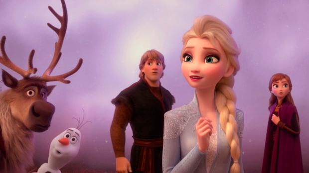"""This image released by Disney shows characters, from left, Sven, Olaf, voiced by Josh Gad, Kristoff, voiced by Jonathan Groff, Elsa, voiced by Idina Menzel, and Anna, voiced by Kristen Bell in a scene from """"Frozen 2."""" (Disney via AP)"""