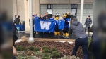 "Mayor Brian Bowman leads the proceedings as the Blue Bombers ""W"" flag is raised, November 19, 2019  at City Hall in advance of the team's appearance in the 107th Grey Cup,"
