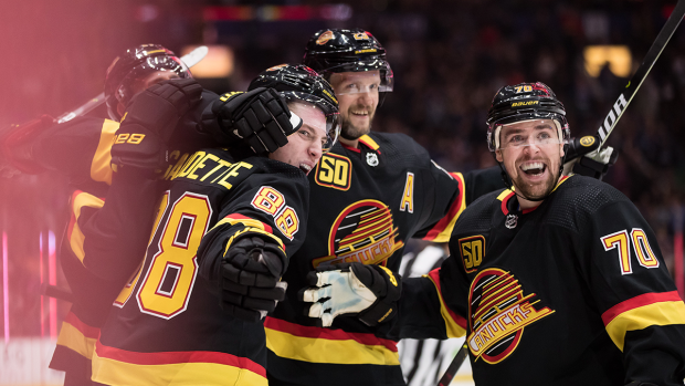 Vancouver Canucks' Adam Gaudette, front left, Alexander Edler (23), of Sweden, Tanner Pearson (70) and Josh Leivo, back left, celebrate Gaudette's goal against the Colorado Avalanche during the second period of an NHL hockey game in Vancouver, on Saturday, Nov. 16, 2019. (Darryl Dyck / THE CANADIAN PRESS)