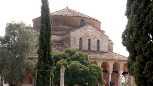 In this photo taken on Wednesday, March, 28, 2018, the Santa Maria Fosca Church, adjacent to the Santa Maria Assunta Basilica, one of the most ancient churches in Venice, located on the lagoon island of Torcello, Italy. (AP Photo/Martino Masotto)