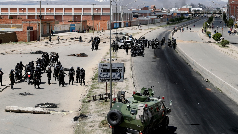 Security forces guard the state-own Senkata filling gas plant in El Alto, on the outskirts of La Paz, Bolivia, Tuesday, Nov. 19, 2019. (AP Photo/Natacha Pisarenko)