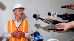 Baseball Commissioner Rob Manfred speaks to the media during a tour of the under construction new Texas Rangers stadium in Arlington, Texas, Tuesday, Nov. 19, 2019. (AP Photo/LM Otero)