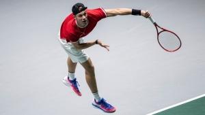 Canada's Denis Shapovalov serves to Italy's Matteo Berrettini during their Davis Cup tennis match in Madrid, Spain, Monday, Nov. 18, 2019. (AP Photo/Bernat Armangue)