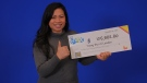 Trang Bui of London, Ont. picks up her winning Lotto Max cheque in Toronto. (Source: OLG)