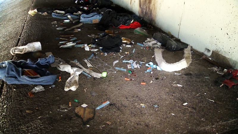 A Lethbridge group has pulled back from a plan to have people collect buckets of needles and drug paraphernalia