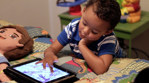 In this Friday, Oct. 21, 2011 photo, Frankie Thevenot, 3, plays with an iPad in his bedroom. A recent study found that moms tend to favour girls expressing emotions of sadness and anger over boys. Fathers, on the other hand, lacked a bias towards emotions of anger and sadness in their children. (CP)