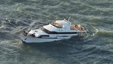 Footage from CTV News Vancouver's Chopper 9 shows a partially submerged yacht off B.C.'s South Coast.