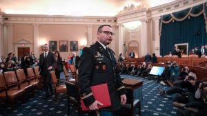 National Security Council aide Lt. Col. Alexander Vindman departs after testifying before the House Intelligence Committee on Capitol Hill in Washington, Tuesday, Nov. 19, 2019, during a public impeachment hearing of President Donald Trump's efforts to tie U.S. aid for Ukraine to investigations of his political opponents. (AP Photo/J. Scott Applewhite)