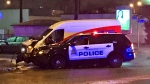 An Edmonton police cruiser and a Canada Post van crashed north of downtown on Tuesday night, sending four people to hospital. Nov. 19, 2019. (CTV News Edmonton)