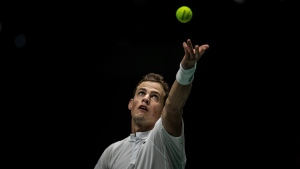 Canada's Vasek Pospisil serves to Reilly Opelka during their Davis Cup tennis match in Madrid, Spain, Tuesday, Nov. 19, 2019. (AP Photo/Bernat Armangue)