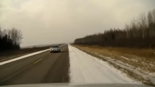A 19-year-old driver has been slapped with some hefty fines after Manitoba RCMP caught her on a dash cam allegedly driving while distracted. (Source: RCMP)