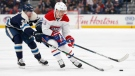 Montreal Canadiens' Max Domi, right, carries the puck up ice as Columbus Blue Jackets' Eric Robinson defends during the third period of an NHL hockey game Tuesday, Nov. 19, 2019, in Columbus, Ohio. The Blue Jackets beat the Canadiens 5-2. (AP Photo/Jay LaPrete)