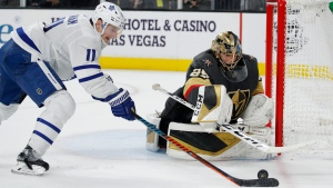 Vegas Golden Knights goaltender Marc-Andre Fleury (29) blocks a shot by Toronto Maple Leafs center Zach Hyman (11) during the third period of an NHL hockey game Tuesday, Nov. 19, 2019, in Las Vegas. (AP Photo/John Locher)