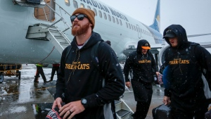 Hamilton Tiger-Cats quarterback Dane Evans, centre, arrives with his team as Grey Cup week gets underway in Calgary, Tuesday, Nov. 19, 2019.THE CANADIAN PRESS/Jeff McIntosh
