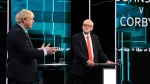 In this photo issued by ITV, Jeremy Corbyn, right, and Boris Johnson, during the election head-to-head debate live on TV, in Salford, Manchester, England, Tuesday, Nov. 19, 2019. (ITV via AP)