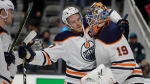 Edmonton Oilers goalie Mikko Koskinen (19) celebrates with Connor McDavid at the end of an NHL hockey game against the San Jose Sharks on anm Tuesday, Nov. 19, 2019, in San Jose, Calif. (AP Photo/Ben Margot)