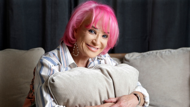 In this Aug. 20, 2019, file photo, Tanya Tucker sits for a portrait session in Nashville, Tenn. Tucker, who released her first album of new songs in 17 years in August, received four Grammy Award nominations on Wednesday, Nov. 20. (AP Photo/Mark Humphrey, File)