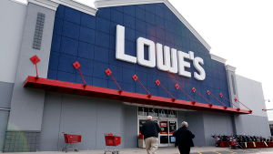 In this Nov. 14, 2011 file photo, customers walk toward the Lowe's store in Saugus, Mass. (AP / Michael Dwyer)