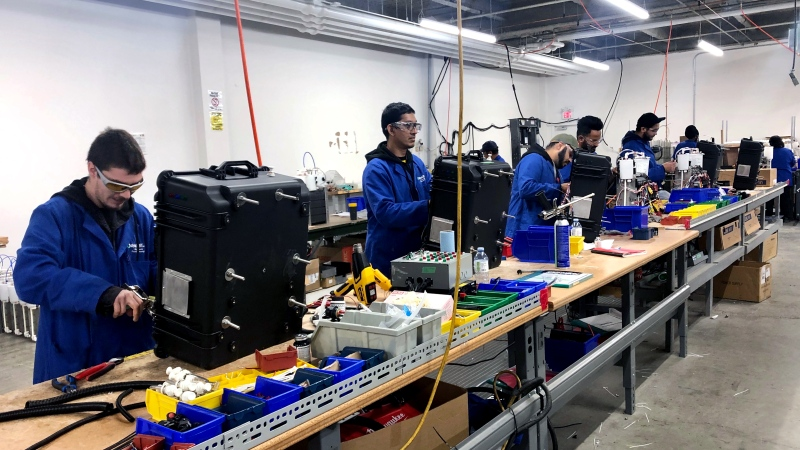 An assembly line working on dynaCERT's HydraGEN device is seen at the company's Etobicoke facility. (CTV News Toronto / Natalie Johnson)