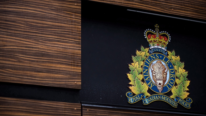 "In this file photo, the RCMP badge is seen outside Royal Canadian Mounted Police ""E"" Division Headquarters, in Surrey, B.C., on Friday April 13, 2018. THE CANADIAN PRESS/Darryl Dyck"