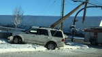 A damaged SUV next to a sheared power pole at the intersection of Centre Ave and 19 St NE (photo: Korben Dallas)