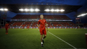 Canada midfielder Liam Fraser leaves the soccer field prior to the start CONCACAF Nations League play against Cuba at BMO Field in Toronto, Saturday, Sept. 7, 2019. THE CANADIAN PRESS/Cole Burston