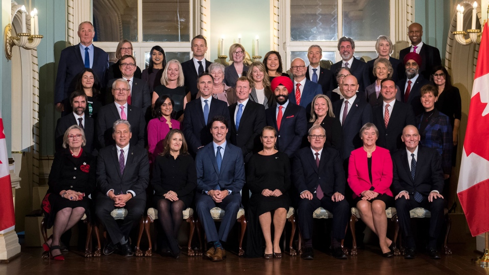 The new Liberal minority cabinet pose for a family photo following their swearing in at Rideau Hall in Ottawa on Wednesday, Nov. 20, 2019. THE CANADIAN PRESS/Justin Tang