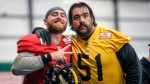 Hamilton Tiger-Cats quarterback Dane Evans, left, and teammate Mike Filer ham it up during practice for the CFL Grey Cup in Calgary, Wednesday, Nov. 20, 2019. THE CANADIAN PRESS/Jeff McIntosh
