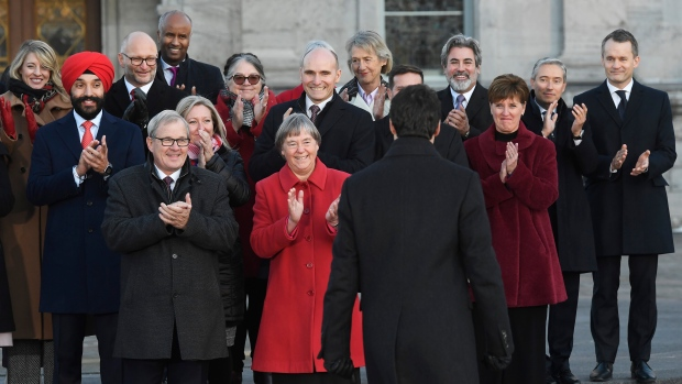 Prime Minister Justin Trudeau is applauded by newly named Liberal cabinet ministers following the swearing-in of the new cabinet at Rideau Hall in Ottawa on Wednesday, Nov. 20, 2019. THE CANADIAN PRESS/Adrian Wyld