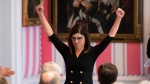 Minister of Labour Filomena Tassi raises her hands after being sworn in during a ceremony at Rideau Hall in Ottawa, on Wednesday, Nov. 20, 2019. THE CANADIAN PRESS/Justin Tang