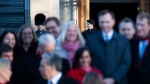 Prime Minister Justin Trudeau is seen behind members of his cabinet as he arrives to speak to reporters following a swearing in ceremony at Rideau Hall in Ottawa, on Wednesday, Nov. 20, 2019. THE CANADIAN PRESS/Justin Tang