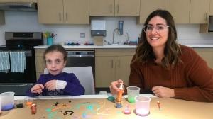 Violet Revet, 10, sits with child life specialist  Karyn Fife.