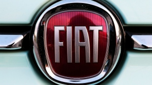 In this Oct. 31, 2019 file photo, a Fiat logo is pictured on a car in Bayonne, southwestern France. (AP Photo/Bob Edme, File)