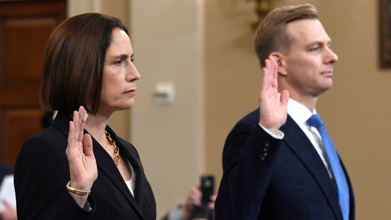 Former White House national security aide Fiona Hill, and David Holmes, a U.S. diplomat in Ukraine, are sworn in to testify before the House Intelligence Committee on Capitol Hill in Washington, Thursday, Nov. 21, 2019. (AP Photo/Susan Walsh)
