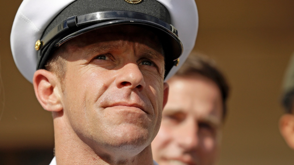 Trump says he won't allow U.S. Navy to punish SEAL who posed with corpse