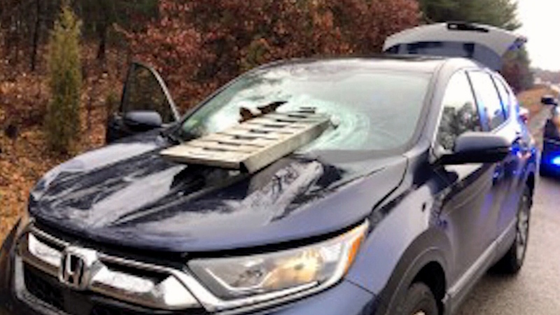 Truck ramp goes through woman's windshield