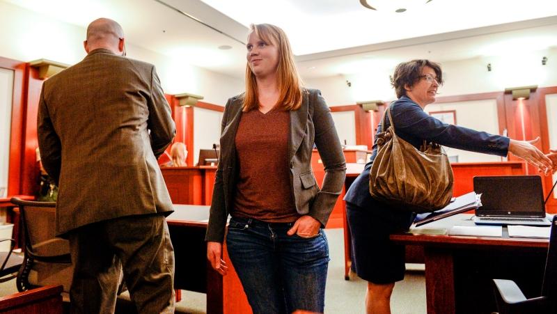Tilli Buchanan smiles as she leaves Judge Kara Pettit's Third District Courtroom, Tuesday, Nov. 19, 2019, in Salt Lake City. (Leah Hogsten/The Salt Lake Tribune via AP)