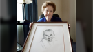 Ann Taylor Cook is shown in February 2004 with a copy of her photo that is used on all Gerber baby food products. (Chris O'Meara/AP)