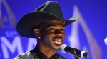 This Nov. 13, 2019 file photo shows rapper Lil Nas X after winning the musical event of the year award at the 53rd annual CMA Awards in Nashville, Tenn. (Photo by Evan Agostini/Invision/AP, File)