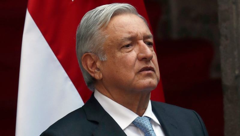 Mexico's President Andres Manuel Lopez Obrador attends a welcoming ceremony for the prime minister of Singapore, at the National Palace in Mexico City, Tuesday, Nov. 19, 2019. (AP Photo/Marco Ugarte)