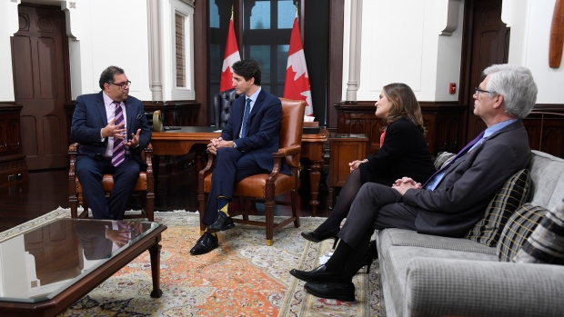 Deputy Prime Minister Chrystia Freeland and Jim Carr, right, look on as Prime Minister Justin Trudeau speaks with Calgary mayor Naheed Nenshi in his office on Parkiament Hill in Ottawa, Thursday November 21, 2019. THE CANADIAN PRESS/Adrian Wyld