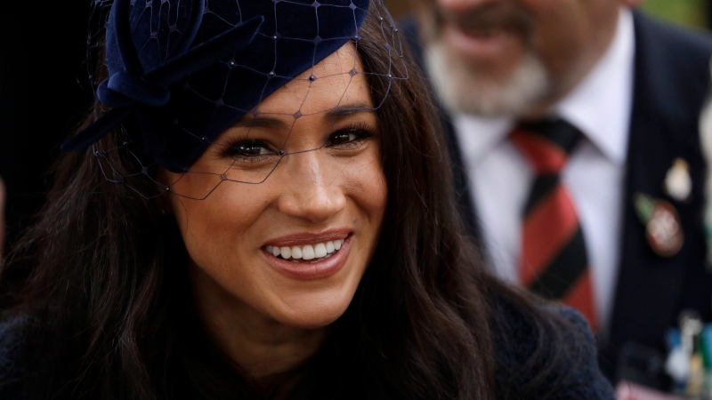Meghan, the Duchess of Sussex, meets veterans and serving members of the military as she attends the official opening of the annual Field of Remembrance at Westminster Abbey in London, Thursday, Nov. 7, 2019. (AP Photo/Matt Dunham)