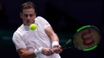 Canada's Vasek Pospisil returns the ball to Australia's John Millman during the Davis Cup tennis match in Madrid, Spain, Thursday, Nov. 21, 2019. (AP Photo/Manu Fernandez)