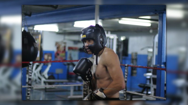 He fell 13 years ago, but Albert Liaw is back up, teaching the next generation of boxers.