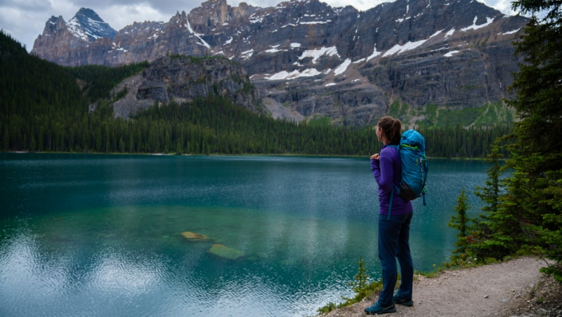 A hiker looks at Lake O'Hara, located in Yoho National Park, in this undated handout image. (The Canadian Press/HO-Parks Canada-Zoya Lynch)