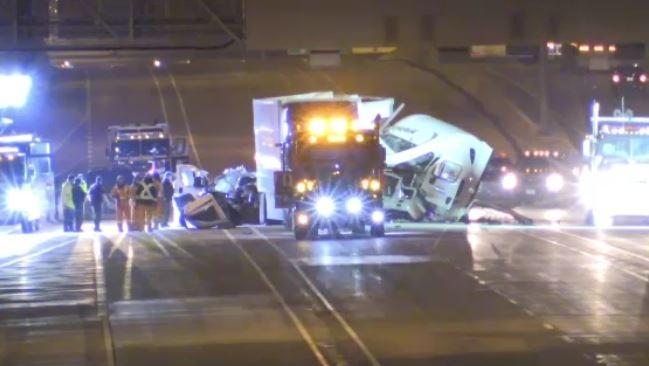 Emergency crews work at the scene of a fatal crash on Highway 402 near Christina Street in Sarnia, Ont. on Wednesday, Nov. 20, 2019. (Taylor Choma / CTV London)