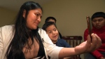 Sandra Morales, 34, her sons, Aaron, 4, and Gimber, 18, Skype chat with the boys dad Daniel in Guatemala. (CTV)