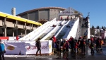 The Jiffy Lube tube slide has proven popular with football fans at the Grey Cup Nissan Titan Street Festival at Stampede Park