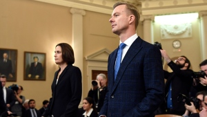 Former White House national security aide Fiona Hill, and David Holmes, a U.S. diplomat in Ukraine, arrive back from a break to testify before the House Intelligence Committee on Capitol Hill in Washington, Thursday, Nov. 21, 2019, during a public impeachment hearing of President Donald Trump's efforts to tie U.S. aid for Ukraine to investigations of his political opponents.(AP / Susan Walsh)