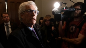 Liberal MP Jim Carr speaks with the media before entering the Prime Minister's office on Parliament Hill in Ottawa on Thursday November 21, 2019. THE CANADIAN PRESS / Adrian Wyld